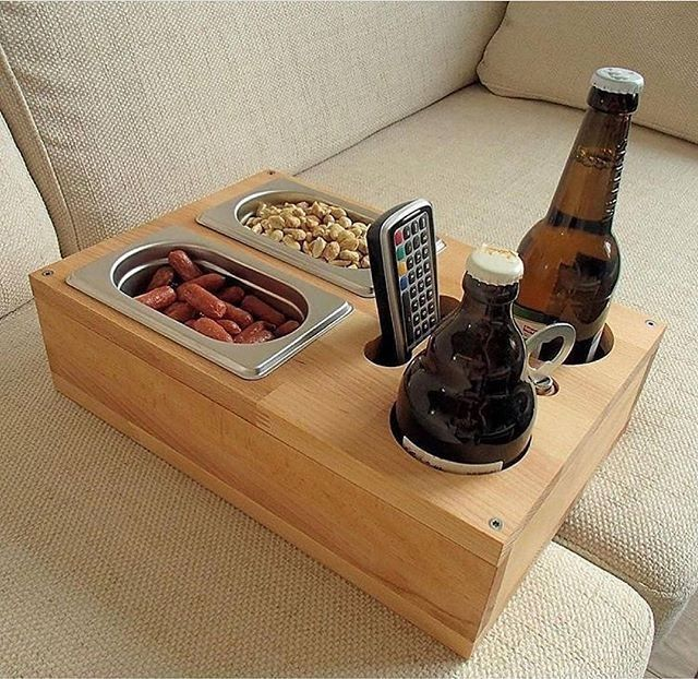 Wooden box for serving drinks and snacks on the sofa. Also holds the f ...