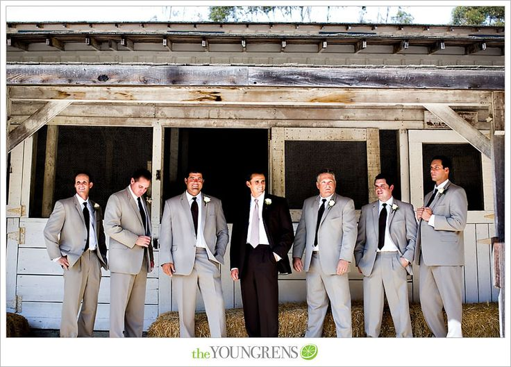 tan groomsmen suits and a black suit for the groom..i'm kinda liking this a ...