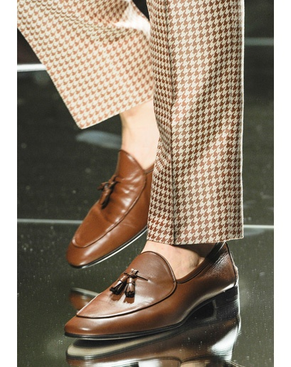 Shoes I can care less about, but the houndstooth pants are sick. A bit feminine,...