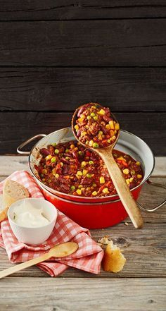 Chili con carne with minced meat, kidney beans, corn, peas, tomatoes, peppers and ...