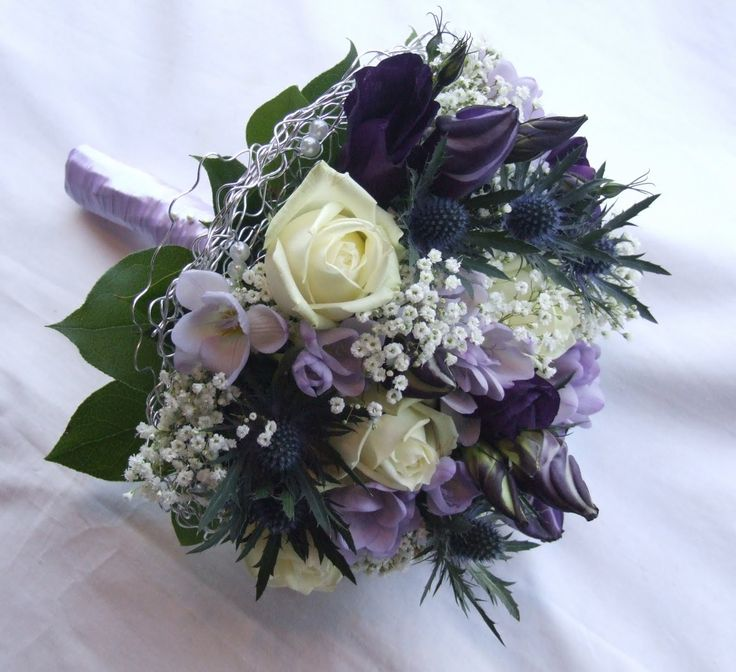 navy and purple weddings   The grooms-men each wore a single ivory rose with ery...