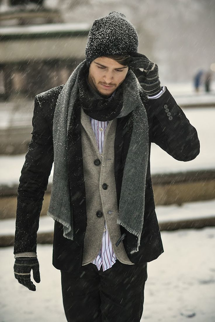 black pea coat, brown wool suit, white and red vertically striped long sleeve shirt, black jeans for