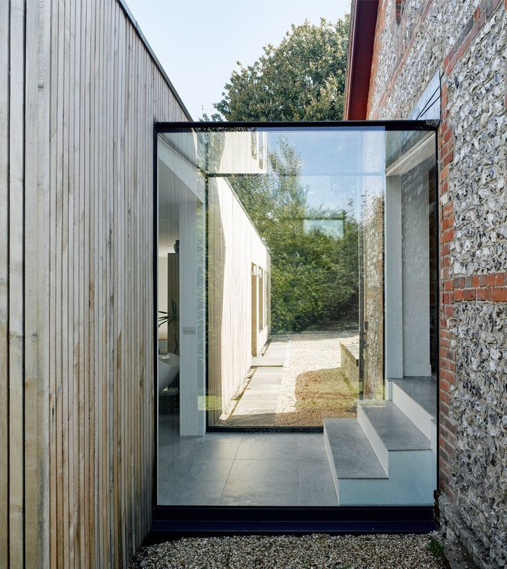 Architect Adam Knibb has added a timber-clad extension to a house in Hampshire, ...