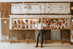 Groomsmen styled in vintage-inspired fashion with brown suspenders  dried flower...