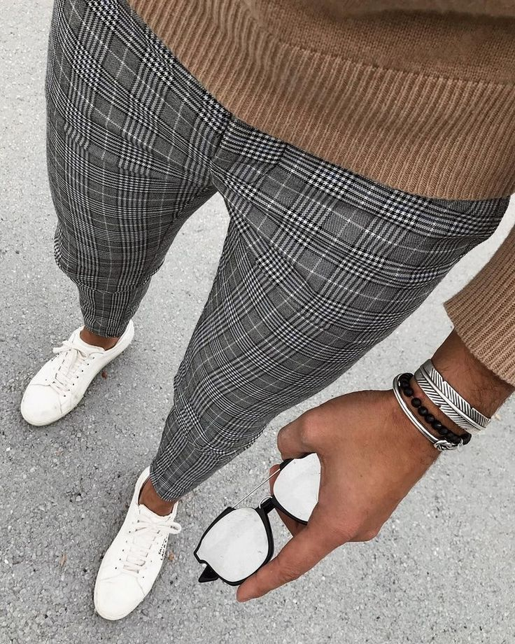 brown pullover with checked trousers and white leather sports shoes combine ...