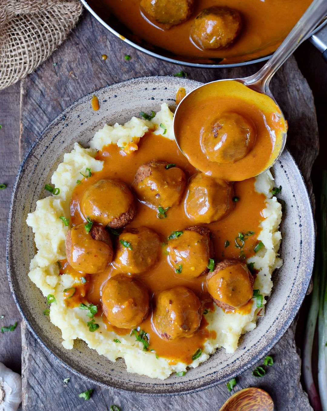 Vegan meatballs with a spicy gravy and mashed potatoes. This...